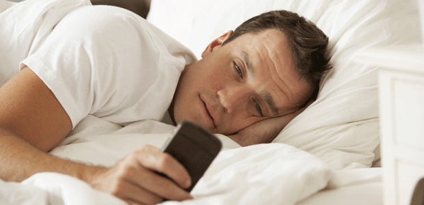using phone on bed