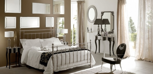 small bedroom with mirrors